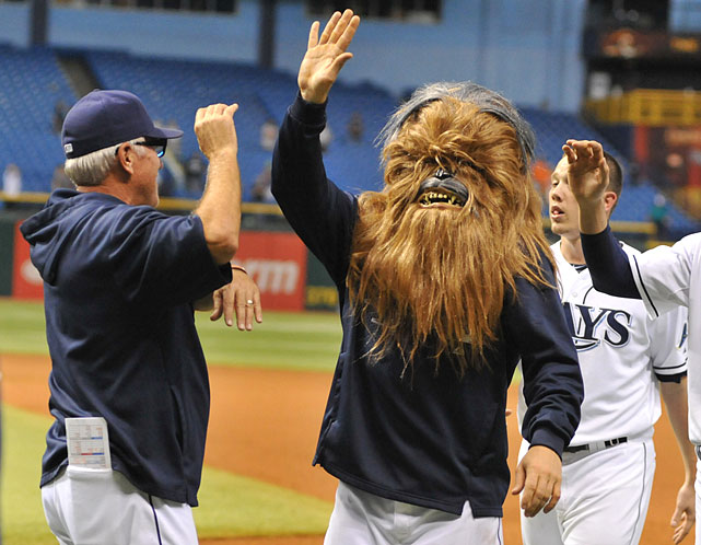 Tampa Bay Rays DH Luke Scott wears a Chewbacca mask as he high-fives manager Joe Maddon after the team's 5-4 win in 18 innings against the Baltimore Orioles on Sept. 20, 2013 at Tropicana Field in St. Petersburg, Fla.