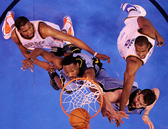 Kevin Durant, Tony Allen, Marc Gasol and Serge Ibaka battle for a rebound during Game 7 of the Memphis Grizzlies-Oklahoma City Thunder first-round series.