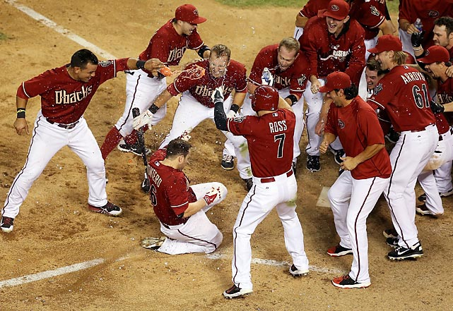 Miguel Montero (26) of the Arizona Diamondbacks is congratulated by teammates after hitting a walk off solo home-run against the Colorado Rockies. Arizona won 5-4 in 10 innings.