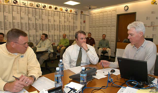 Director of college scouting John Dorsey, head coach Mike McCarthy and general manager Ted Thompson in the Packers war room during the late first round of the 2006 NFL Draft.