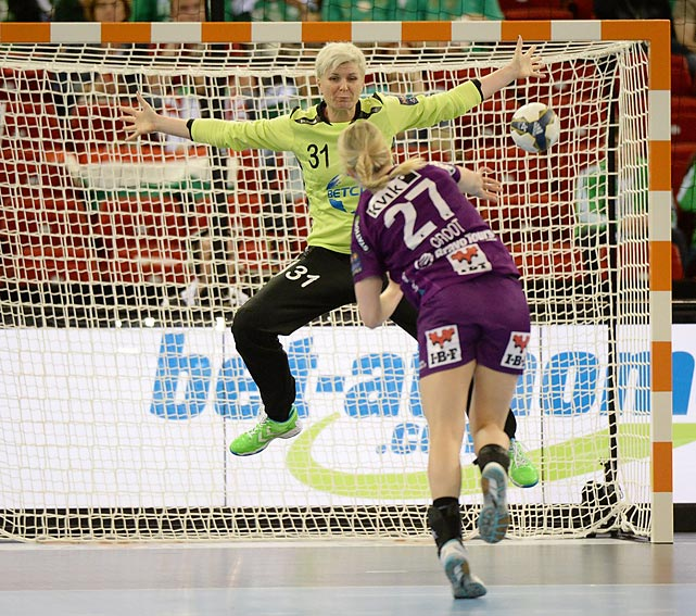 Goalkeeper Inna Suslina defends a shot against FC Midtjylland in the bronze-medal match.