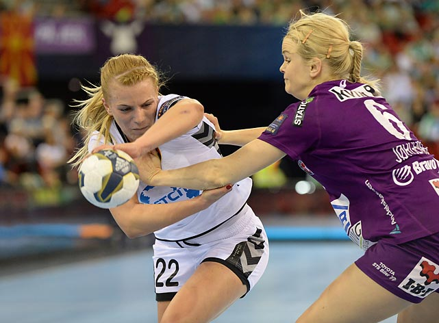 Andrea Klikovac evades Stine Jorgensen of Denmark's FC Midtjylland.