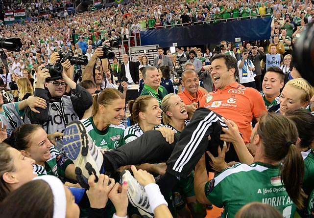 Head coach Martin Ambros of Hungary's Gyori Audi ETO KC celebrates with his players after winning the Champions League final.