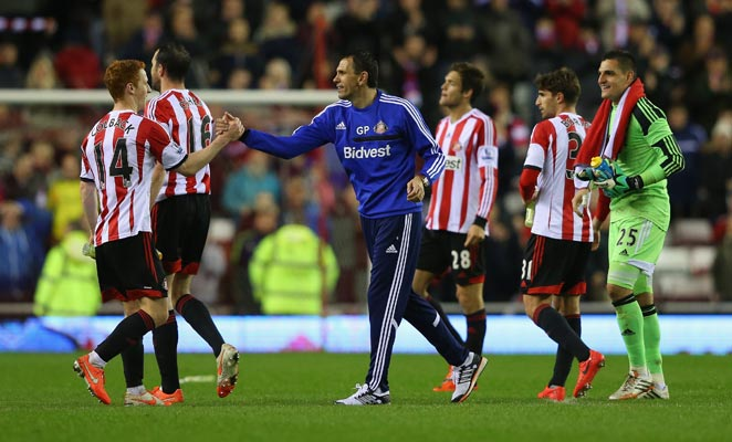 Manager Gus Poyet (center) has led Sunderland to Premier League safety after a disastrous start.