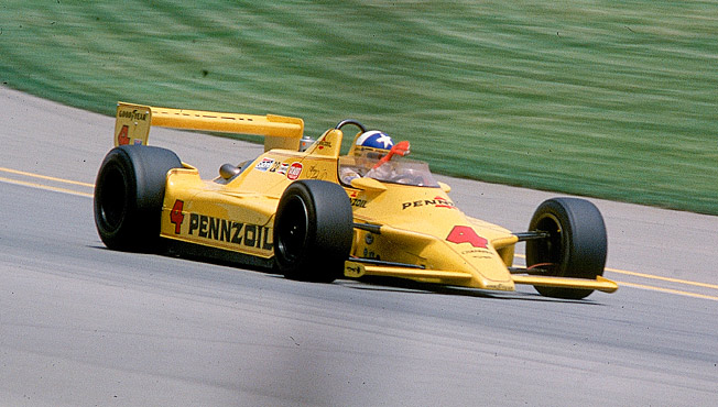 Sky of blue and sea of green, that's Johnny Rutherford in his Yellow Submarine circa 1980.
