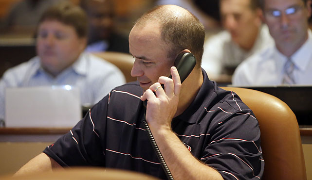 Houston Texans coach Bill O'Brien holds a phone to his ear as he sits in the Texans daft war room Thursday. His team picked Jadeveon Clowney with the first pick.