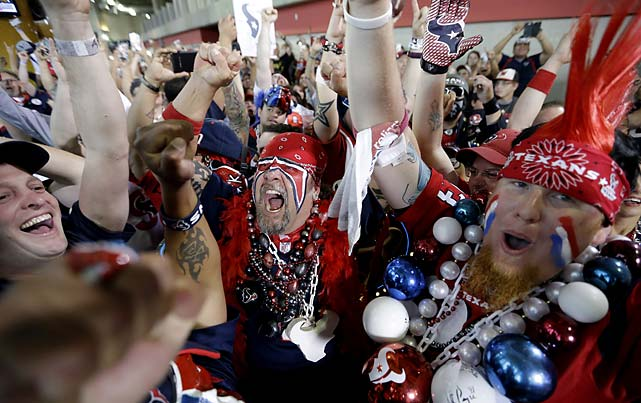 Houston Texans fans celebrate after the team chose South Carolina defensive end Jadeveon Clowney as the number one overall pick.