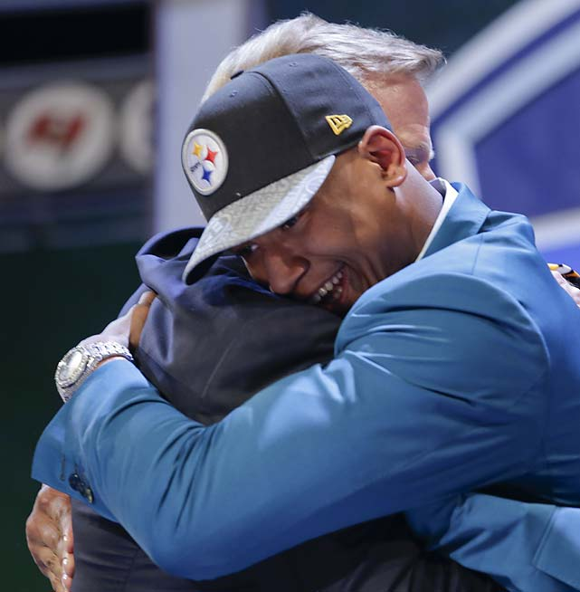 Ohio State outside linebacker Ryan Shazier hugs commissioner Roger Goodell after being selected by the Pittsburgh Steelers as the 15th pick.