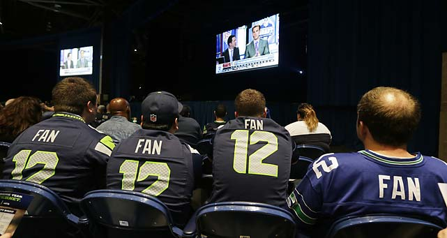 "Spectators wearing Seattle Seahawks ""12th Man"" fan jerseys watch a broadcast of the NFL football draft at the Seattle Seahawks NFL football draft party at the CenturyLink Field Events Center in Seattle."