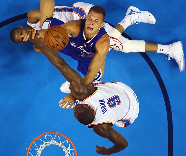 Blake Griffin of the Los Angeles Clippers takes a shot over Russell Westbrook and Serge Ibaka (9) of the Oklahoma City Thunder in Game of a Western Conference semifinal.