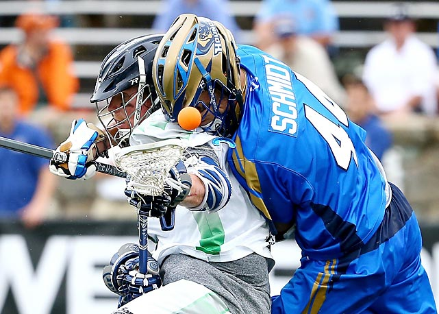 Brendan Mundorf (left) of the Chesapeake Bayhawks and Brett Schmidt of the Charlotte Hounds battle for possession.