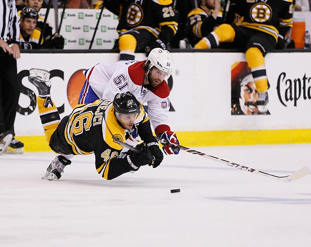 David Krejci of the Boston Bruins and David Desharnais (51) of the Montreal Canadiens fight for the puck during Game 5 of their second-round playoff series.