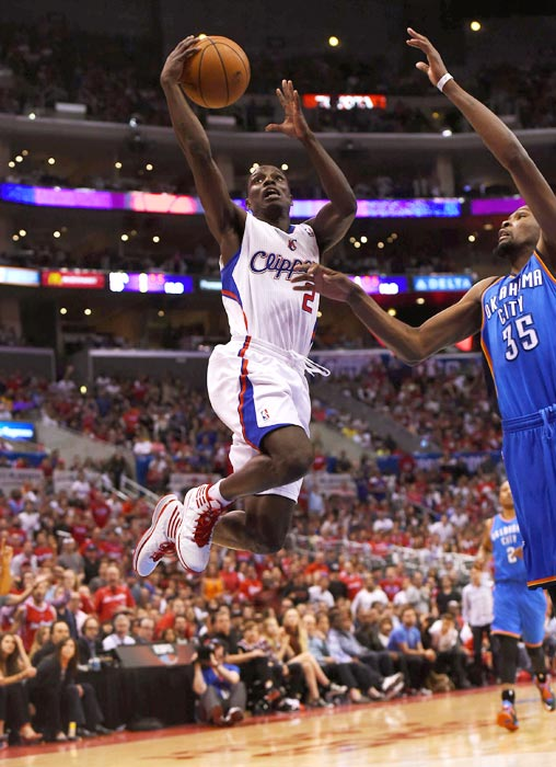 Los Angeles Clippers guard Darren Collison glides past Kevin Durant of the Oklahoma City Thunder in Game 4 of a Western Conference semifinal.
