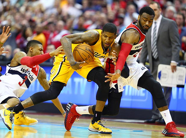 Paul George of the Indiana Pacers secures a loose ball against John Wall (right) and Bradley Beal of the Washington Wizards in Game 4 of their playoff series.