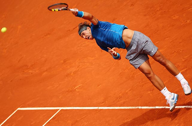 Spain's Rafael Nadal serves against Juan Monaco of Argentina in their second-round match at the Mutua Madrid Open.