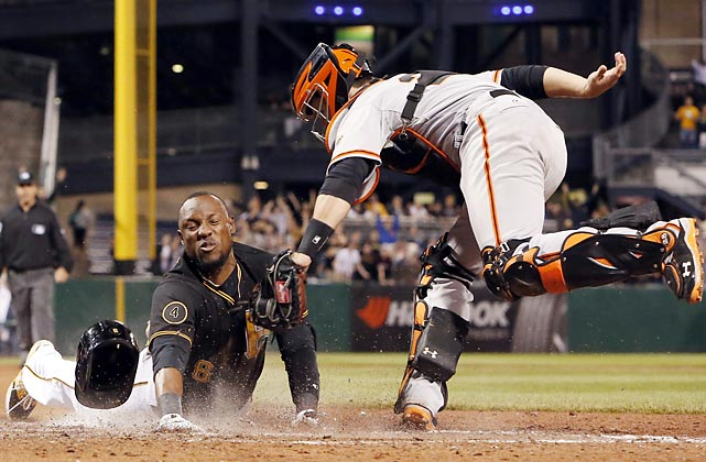Pittsburgh Pirates outfielder Starling Marte beats the tag from San Francisco Giants catcher Buster Posey to score the winning run in the ninth inning. Marte, who hit a triple, was initially called out attempting to score on an errant relay throw. The call was overturned upon review in the first successful walk-off challenge in MLB history. The Pirates won 2-1.