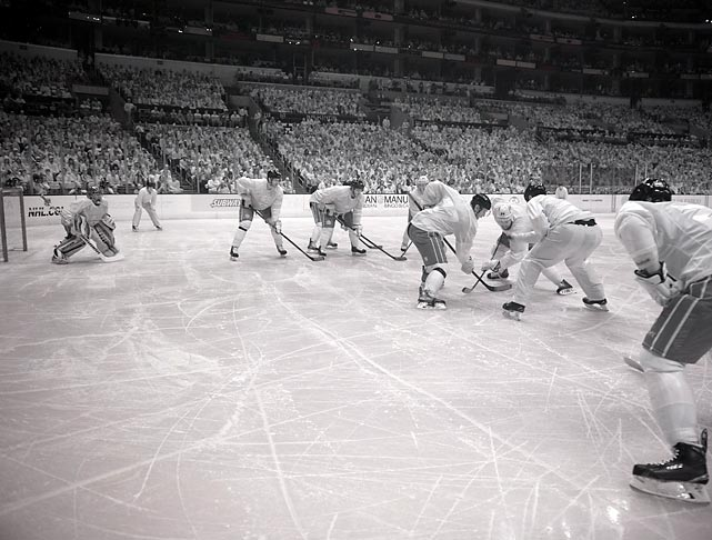 This face-off between the Kings and Ducks last Saturday at the Staples Center was photographed through an infrared camera. Visible wavelengths of lights were screened out, making it difficult to identify who's who. The Ducks won this game 2-0 to even the Western Conference semifinal series at two victories apiece.