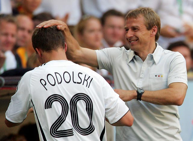 Lukas Podolski receives congratulations from Klinsmann during the 2006 World Cup Round of 16 match against Sweden in Munich.