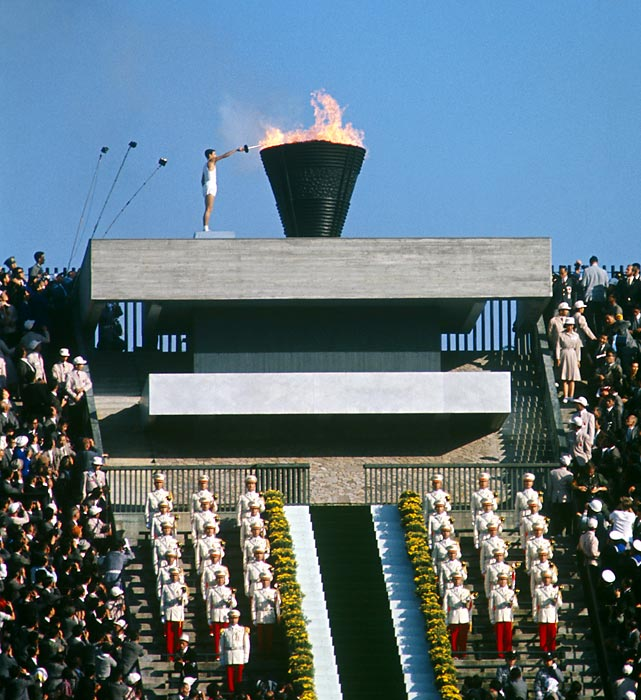Torchbearer Yoshinori Sakai of Japan lights the flame at the 1964 Tokyo Olympics. He was born in Hiroshima on the day an atomic bomb was dropped on that city.