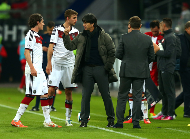 Germany manager Joachim Low, center, has lost his driver's license after being caught speeding multiple times.