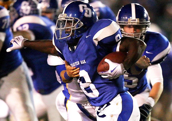 A star at Charter Oak High, Adam Muema (8) had a tendency to keep to himself, according to his coach.