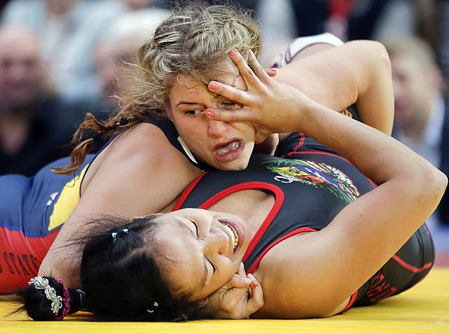 Helen Maroulis of the U.S. pounced on and pinned Marcia Andrades of Venezuela in New York City's famed Times Square, where this kind of thing used to happen at all hours of the day and night back when it was an infamous high crime area. In this instance, the pair were among the potential Olympic athletes from the USA, Russia, Bulgaria, Venezuela and Canada who came to grapple with the big issues of the day as well as each other.