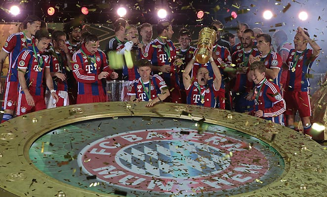 Bayern Munich won the German Cup thanks to extra time goals from Arjen Robben and Thomas Muller.
