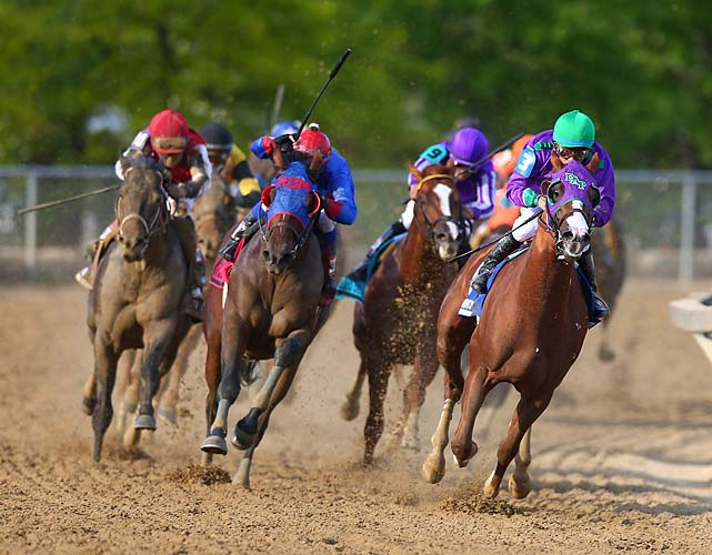 Ride On Curlin, next-to-last in the 10-horse field, ranged up and briefly appeared ready to overtake California Chrome. Once again showing his class, California Chrome denied the threat.