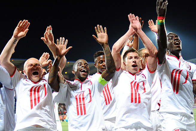 Lille came from a goal down at Lorient to win 4-1 to finish third and nab a Champions League berth.