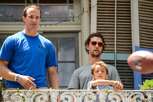 """Drew Brees and Matthew McConaughey watch McConaughey's son Levi throw a football as they participate in a charity """"Amazing Race"""" scavenger hunt on a French Quarter balcony in New Orleans on May 17, 2014. It turned out another celebrity, Brad Pitt, was staying across the street. 2014 has been a good year for Matthew McConaughey, winning the Best Actor Oscar for his role in <italics>Dallas Buyers Club </italics>along with the critical acclaim (and potential Emmy nomination) he received for his role in the HBO series """"True Detective."""" Here's a gallery of the avid sports fan through the years."""