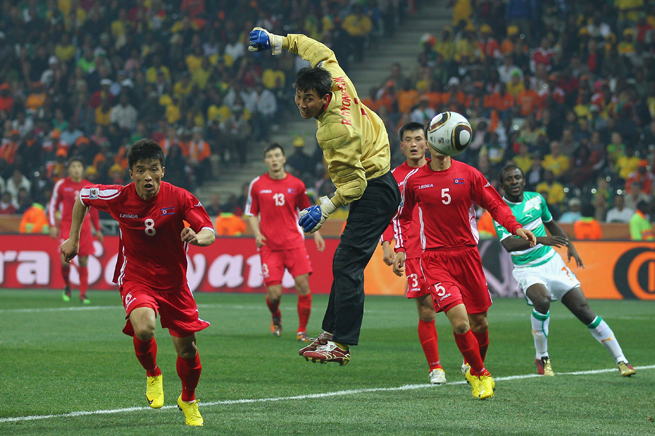 North Korea players chase down the ball while playing against Ivory Coast in the 2010 World Cup in South Africa.