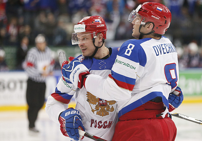 Alex Ovechkin (right) returned from a leg injury with a brace for Russia's win over France.