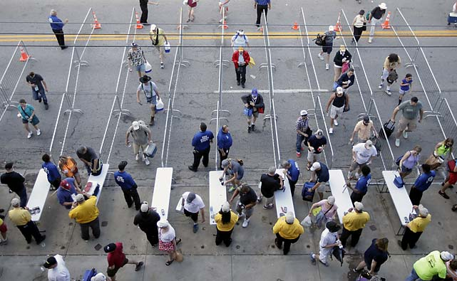 Fans make their way though a security checkpoint as they enter the Indianapolis Motor Speedway.