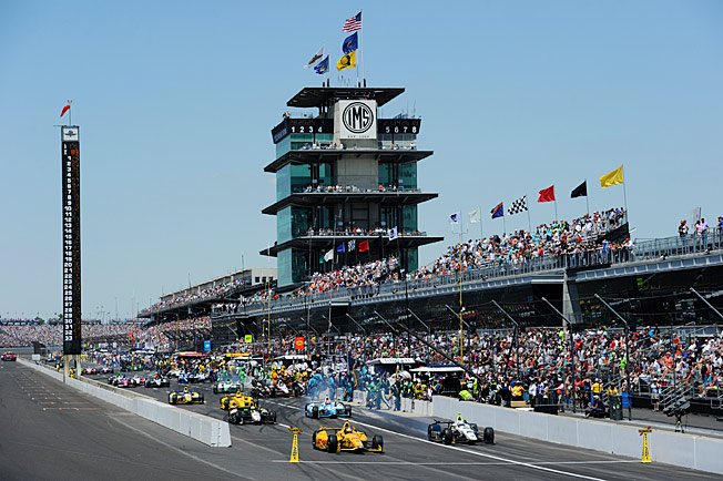 Ryan Hunter-Reay (bottom left) blasts out of the pits during the race's final stop en route to victory.