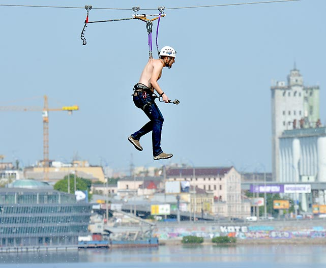 Hung by his skin on his back, this plucky fella crossed Kiev's Dniper River on a 552-meter long cable stretched between the banks. The pleasure was all his...
