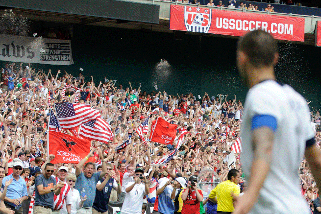 U.S. captain looks back at a raucous crowd section during the USA's friendly vs. Germany last June. For some fans, the live experience is the best way to consume the game. But not for all.
