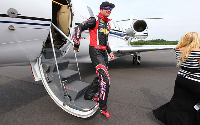 Busch deplanes in Charlotte and heads to a helicopter that would transport him to the NASCAR track.