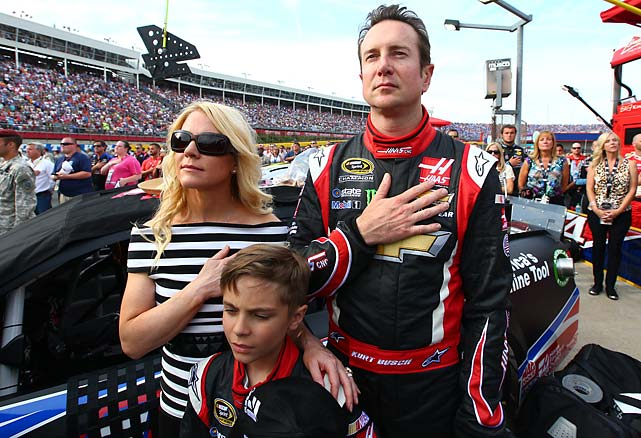 Busch and the Driscolls during the pledge of allegiance.