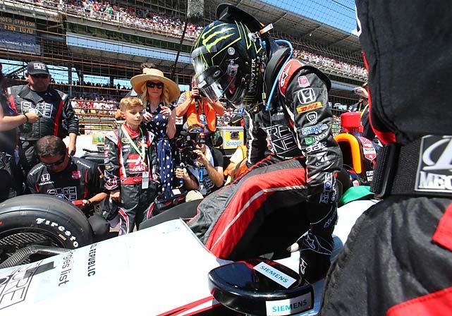 Busch climbs into his car (No. 26) at Indy.