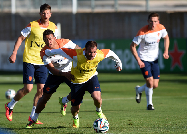 Netherlands veteran midfielder Rafael van der Vaart, front center, will miss the World Cup after suffering a calf injury.