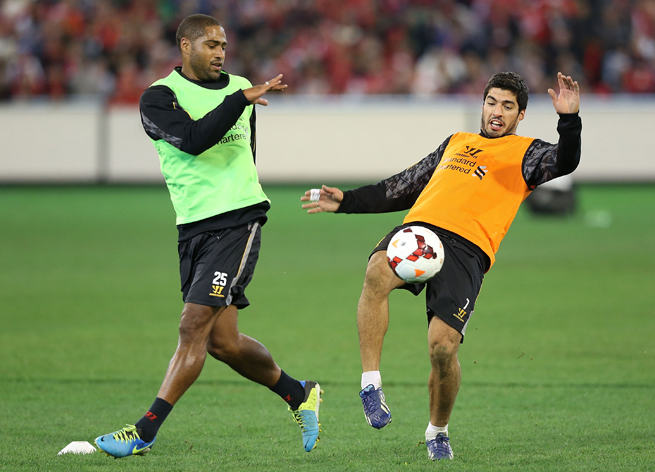 Luis Suarez, right, has told Liverpool teammate Glen Johnson, left, that he'll be OK to play in the World Cup following recent knee surgery.
