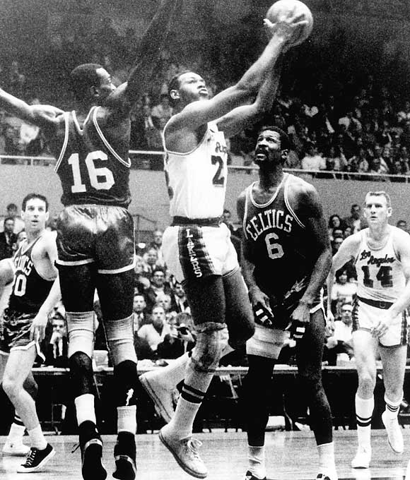 Elgin Baylor of the Lakers erupted for a Finals-record 61 points and grabbed 22 boards against the Celtics in a 126-121 Game 5 win at Boston Garden. The Lakers took a 3-2 series lead in what became a classic first finals meeting between L.A. and Boston.