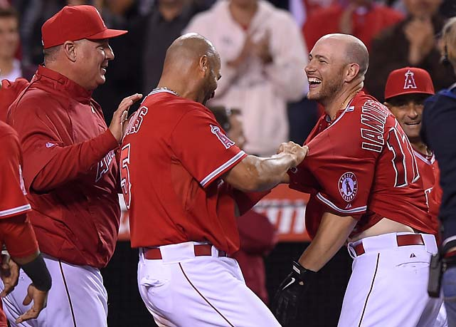 Albert Pujols, center, tries to rip the jersey off Chris Iannetta after Iannetta hit a 12th-inning home run to defeat the Oakland Athletics on April 16.