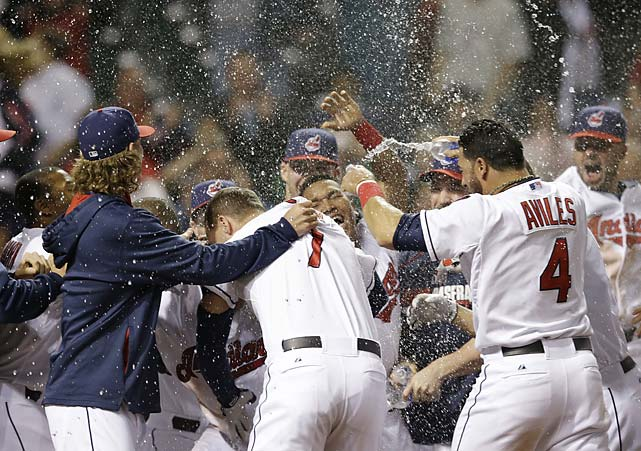 The Cleveland Indians celebrate after Michael Brantley hit a game-winning solo homer in the tenth inning of a May 19 game against Detroit.