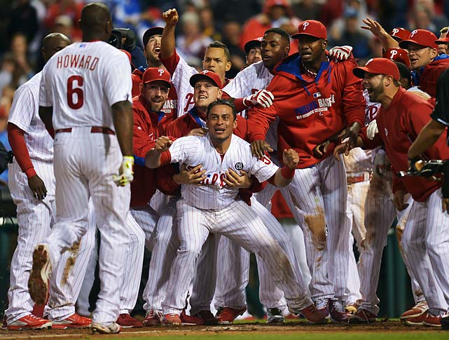 The Philadelphia Phillies wait at home plate for Ryan Howard after he hit a walk-off three-run home run in the ninth inning against the Colorado Rockies on May 28.