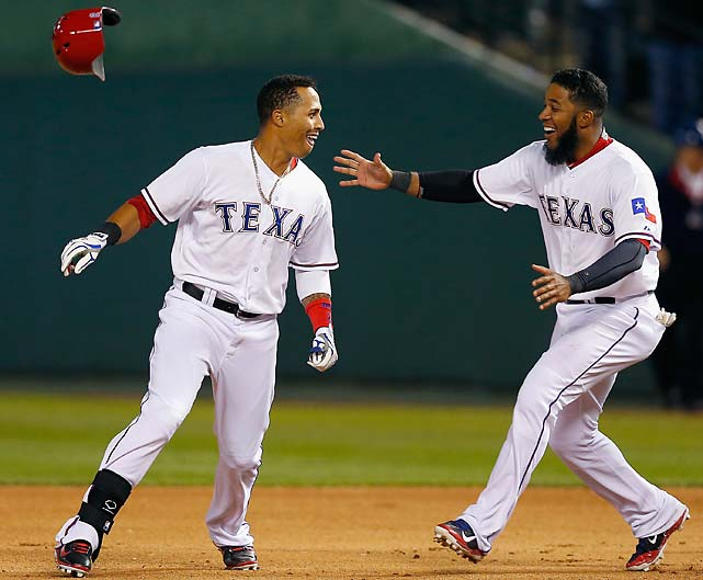 Leonys Martin, left, celebrates with Elvis Andrus after Martin hit a walk-off RBI single in the bottom of the ninth inning against the Seattle Mariners on April 16.