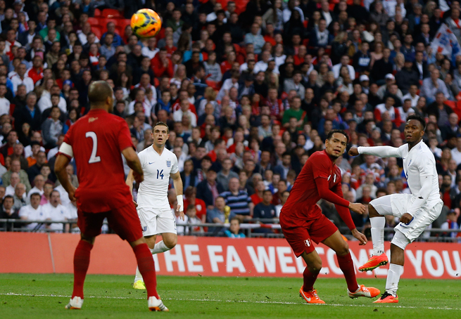England's Daniel Sturridge, right, curls in a beauty for the Three Lions' opening goal in a 3-0 win over Peru at Wembley Stadium in London on Friday.
