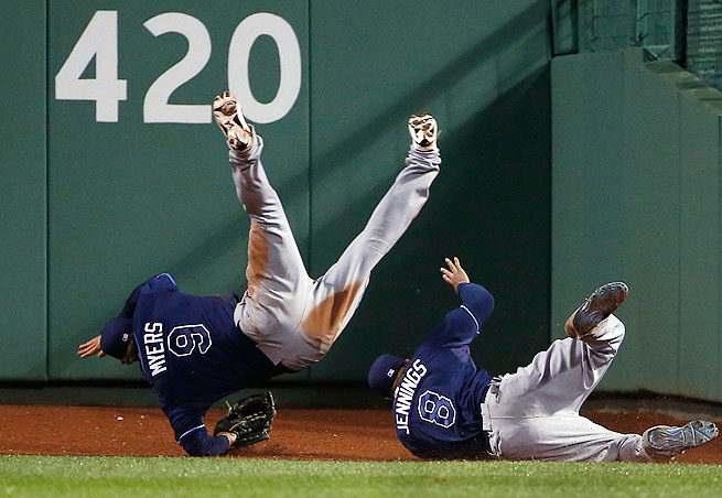 Wil Myers (left) collided with centerfielder Desmond Jennings in pursuit of A.J. Pierzynski's walk-off triple in the 10th inning Friday against Boston.