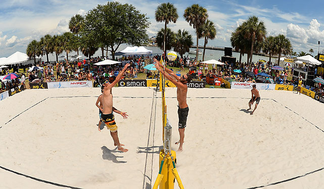 Steve Grotowski spikes while team mate Pedro Brazao watches. Ryan Doherty attempts the block. Nick Lucerna is on the back right.
