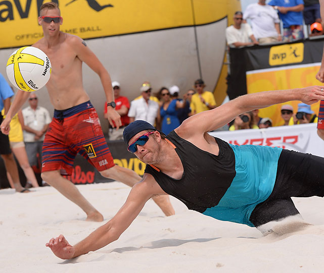 Men's champ Brad Keenan digs a ball in the finals on Sunday.